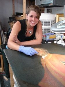 Traci Lindholm Nee (seen here) and Ron Lindholm (not shown) have more than fifty years combined experience working with oil painting conservation.